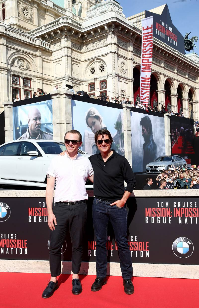 VIENNA, AUSTRIA - JULY 23:  Actors Simon Pegg and Tom Cruise arrive for the world premiere of 'Mission: Impossible - Rogue Nation' at the Opera House (Wiener Staatsoper) on July 23, 2015 in Vienna, Austria.  (Photo by Andreas Rentz/Getty Images for Paramount Pictures International)