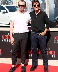 VIENNA, AUSTRIA - JULY 23:  (EDITORS NOTE: This image has been digitally manipulated) Actors Simon Pegg and Tom Cruise arrive for the world premiere of 'Mission: Impossible - Rogue Nation' at the Opera House (Wiener Staatsoper) on July 23, 2015 in Vienna, Austria.  (Photo by Andreas Rentz/Getty Images for Paramount Pictures International)