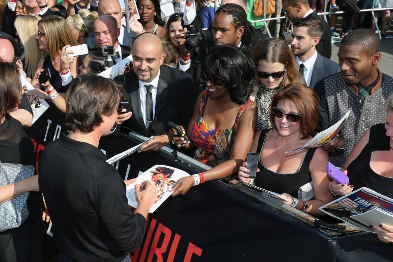 VIENNA, AUSTRIA - JULY 23:  (EDITORS NOTE: This image has been digitally manipulated) Tom Cruise signs autographs during the world premiere of 'Mission: Impossible - Rogue Nation' at the Opera House (Wiener Staatsoper) on July 23, 2015 in Vienna, Austria.  (Photo by Gisela Schober/Getty Images for Paramount Pictures International)