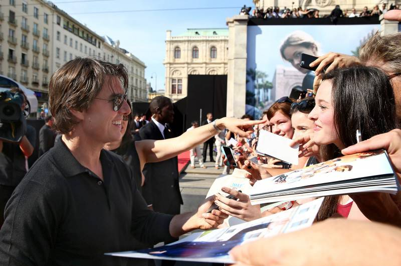 VIENNA, AUSTRIA - JULY 23:  (EDITORS NOTE: This image has been digitally manipulated) Actor Tom Cruise signs autographs for fans as he attends the world premiere of 'Mission: Impossible - Rogue Nation' at the Opera House (Wiener Staatsoper) on July 23, 2015 in Vienna, Austria.  (Photo by Andreas Rentz/Getty Images for Paramount Pictures International)
