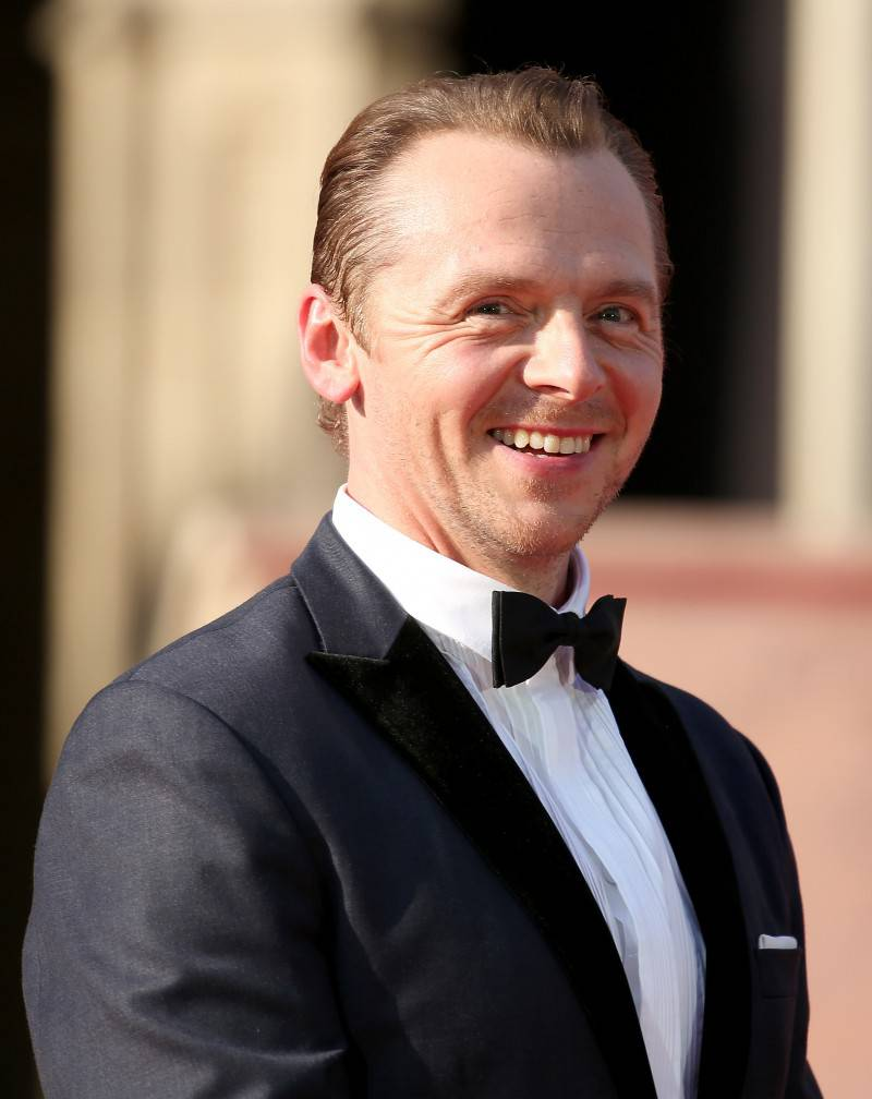 VIENNA, AUSTRIA - JULY 23:  Simon Pegg smiles on stage during the world premiere of 'Mission: Impossible - Rogue Nation' at the Opera House (Wiener Staatsoper) on July 23, 2015 in Vienna, Austria.  (Photo by Monika Fellner/Getty Images for Paramount Pictures International)