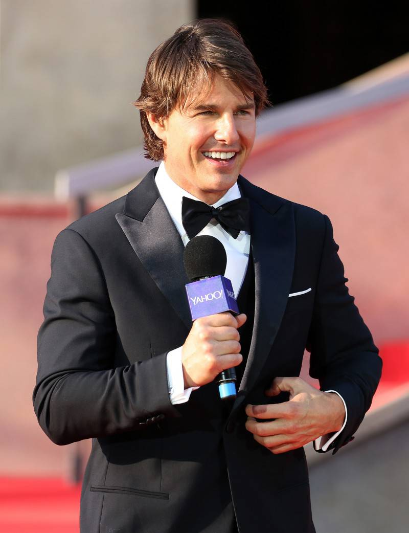 VIENNA, AUSTRIA - JULY 23:  (EDITORS NOTE: This image has been digitally manipulated) Tom Cruise speaks on stage during the world premiere of 'Mission: Impossible - Rogue Nation' at the Opera House (Wiener Staatsoper) on July 23, 2015 in Vienna, Austria.  (Photo by Monika Fellner/Getty Images for Paramount Pictures International)